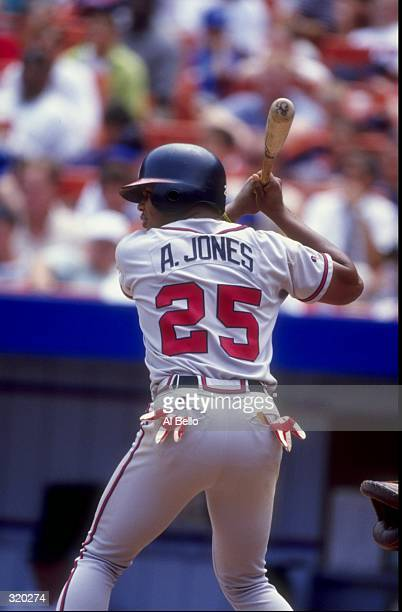 Outfielder Andruw Jones of the Atlanta Braves in action during a game against the New York Mets at Shea Stadium in Flushing New York The Braves...
