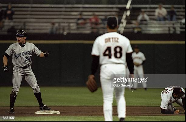 Outfielder Karim Garcia of the Arizona Diamondbacks in action against infielder Rich Aurilia and pitcher Russ Ortiz of the San Francisco Giants...