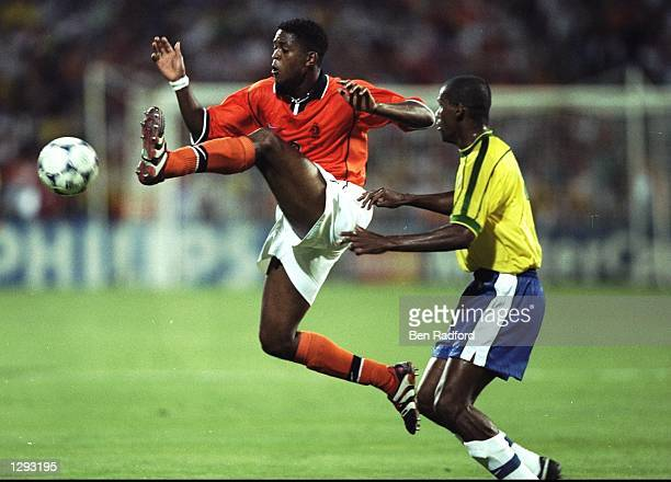 Patrick Kluivert of Holland beats Aldair of Brazil to the ball during the World Cup semifinal at the Stade Velodrome in Marseille France Kluivert...