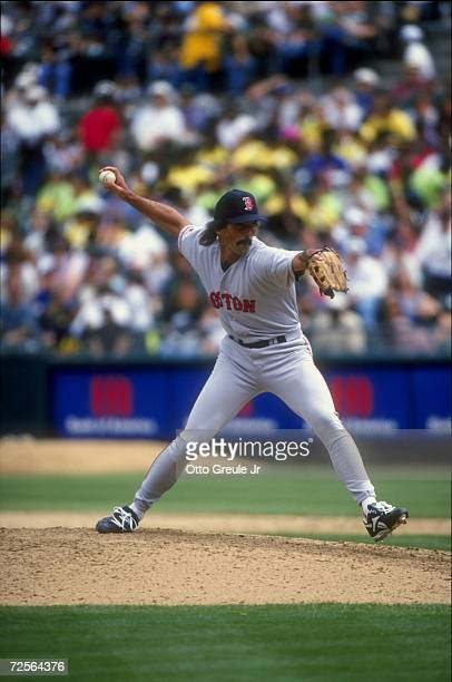 Pitcher Dennis Eckersley of the Boston Red Sox winds up for the pitch during a game against the Oakland Athletics at the Oakland Coliseum in Oakland,...