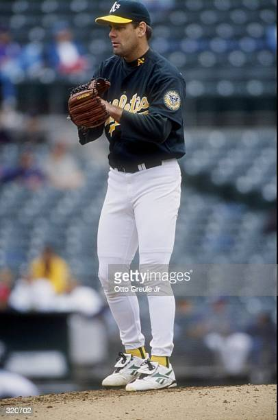 Pitcher Kenny Rogers of the Oakland Athletics in action during a game against the Texas Rangers at the Oakland Coliseum in Oakland, California. The...