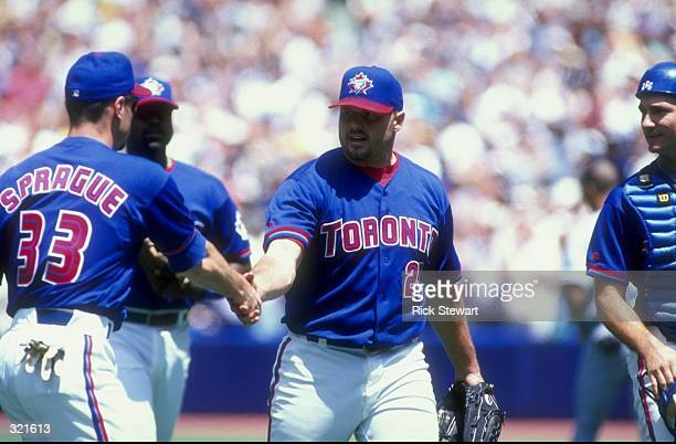 Pitcher Roger Clemens of the Toronto Blue Jays celebrates with teammates during a game against the Tampa Bay Devil Rays at the Sky Dome in Toronto...