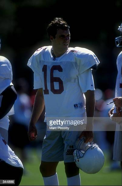 Quarterback Jake Plummer of the Arizona Cardinals looks on during the 1998 Arizona Cardinals training camp at the Northern Arizona University in...