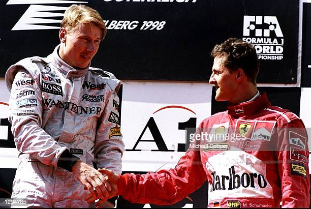 Race winner Mika Hakkinen of McLarenMercedes is congratulated by third place Ferrari driver Michael Schumacher after the Austrian Grand Prix at the...