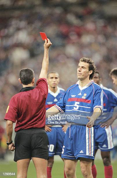 Referee Jose GarciaAranda sends off Laurent Blanc of France for raising a hand at Slaven Bilic of Croatia during the World Cup semifinal at the Stade...