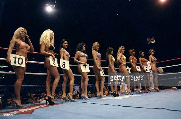 Ring girls display round numbers prior to a bout between Ricardo Rivera and Armando Bosques at the Forum in Inglewood California Mandatory Credit...