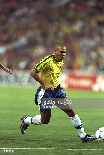 Ronaldo of Brazil runs with the ball in the match between Brazil v Holland in the 1998 World Cup played in Marseille France Mandatory Credit Stu...