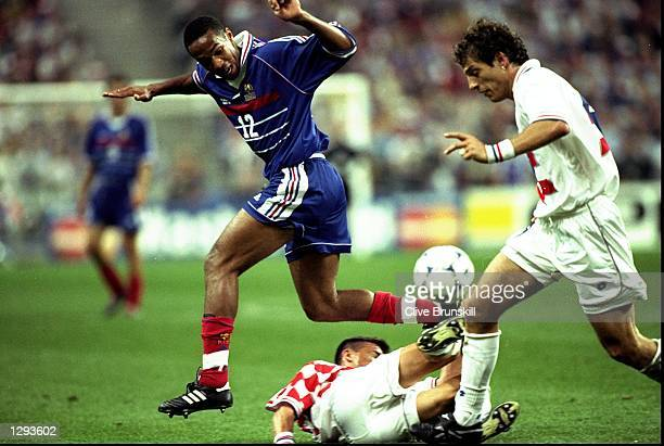 Thierry Henry of France tries to go past Goran Vlaovic of Croatia and team mate Slaven Bilic during the World Cup semi-final at the Stade de France...