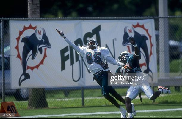Wide receiver Lamar Thomas and cornerback Patrick Surtain of the Miami Dolphins in action during the 1998 Miami Dolphins Training Camp at the Nova...