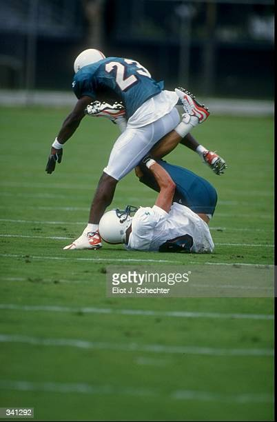 Wide receiver Larry Shannon and cornerback Patrick Surtain of the Miami Dolphins in action during Miami Dolphins training camp in Davie Florida...