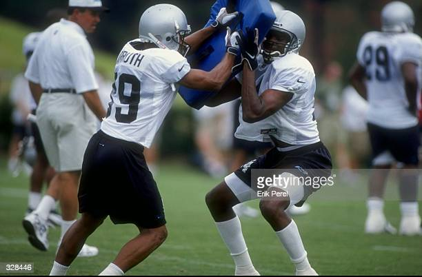 Wide receivers Donald Hayes and Rae Carruth of the Carolina Panthers in action during the 1998 Carolina Panthers Training Camp at the Wofford College...
