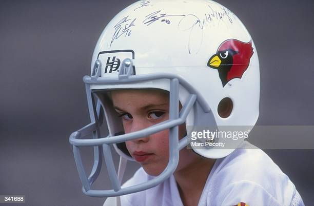 Young fan P J Evans watches the action during the 1998 Arizona Cardinals training camp at the Northern Arizona University in Flagstaff Arizona...