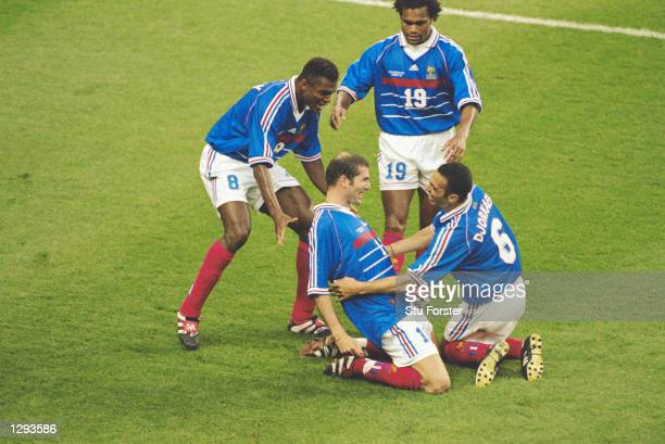 Zinedine Zidane of France celebrates his goal with team mates Youri Djorkaeff Christian Karembeu and Marcel Desailly during the World Cup Final...