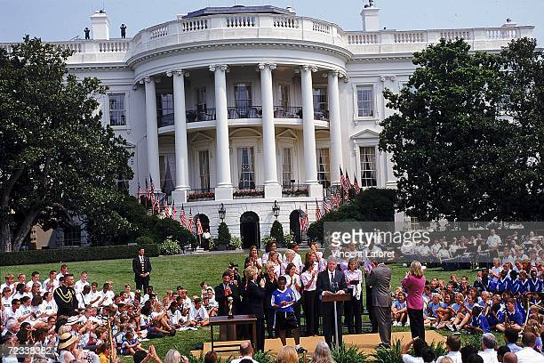 A general view of President Clinton makeing a speech at the podium as the Team USA meets the President at the White House in Washington DC after...