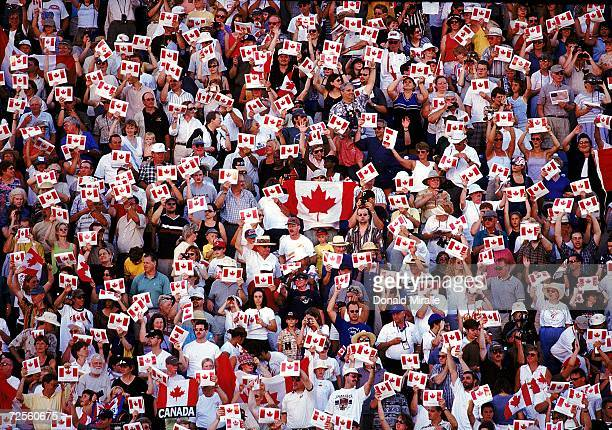 A view of fans waving Canadian flags in the opening ceremony of the PanAmerican Games at Winnipeg Manitoba Canada Mandatory Credit Donald Miralle...