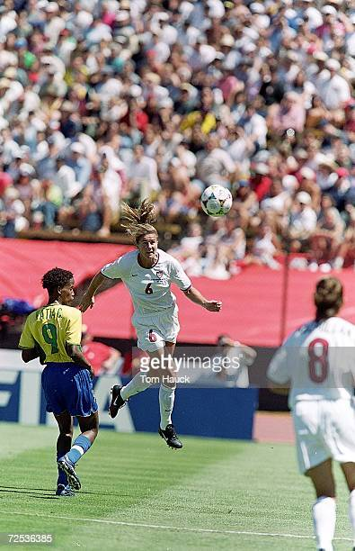 Brandi Chastain of Team USA jumps to head the ball during a Womens World Cup game against Team Brazil at the Stanford Stadium in Palo Alto California...