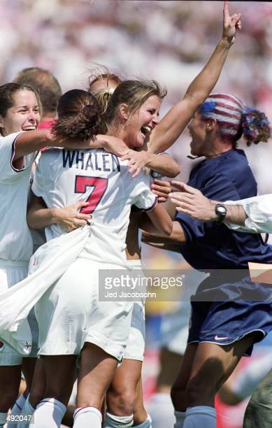 Brandi Chastain of the USA celebrates with her teammates after winning the Womens World Cup final against China at the Rose Bowl in Pasadena...