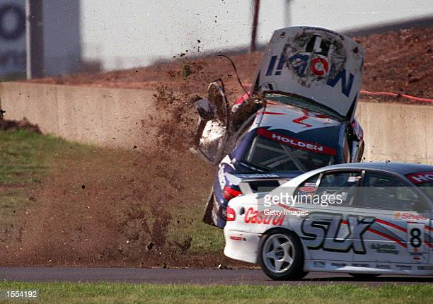 Craig Lowndes for the Mobil Holden Racing Team goes on a wild spin during a crash today at Calder Park Melbourne Australia Lowndes was competing in...
