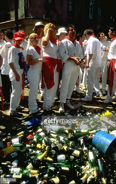 Empty Champagne bottles gather in the square during the San Fermin Fiesta 1999 in Pamplona Spain Noon on the 6th July sees the start of the San...
