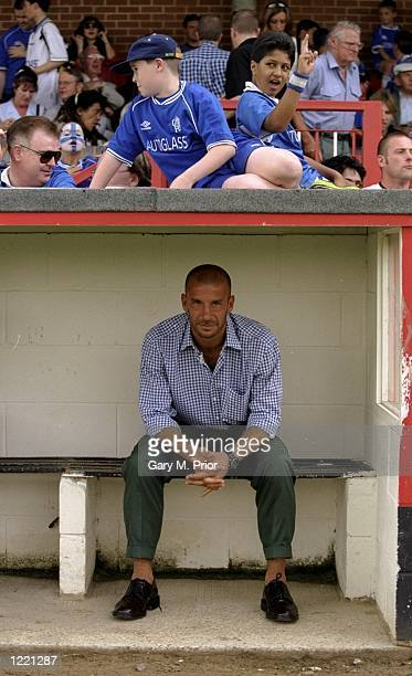 Gianluca Vialli the manager of Chelsea watches from the dugout during the annual preseason friendly match against Kingstonian Football Club played at...
