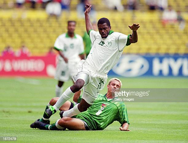 Hamzah Falatah of Saudi Arabia is tackled by Bolivia's Gonzalo Galindo during the 1999 Confederations Cup match against Bolivia played at the Azteca...