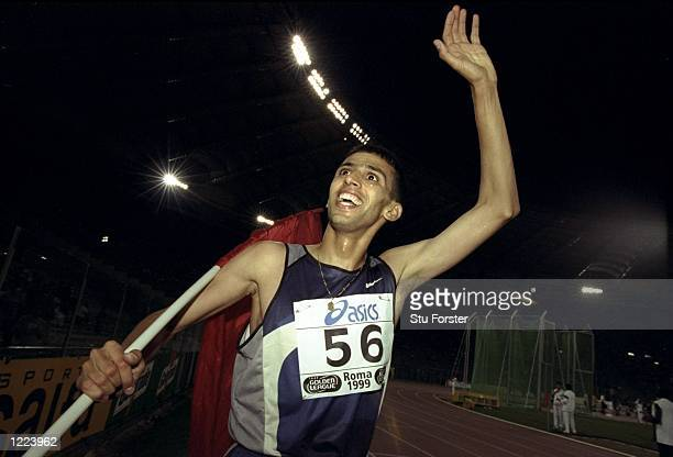 Hicham El Guerrouj of Morocco celebrates victory in the Mile race during the IAAF Golden League Golden Gala held at the Olympic Stadium in Rome,...