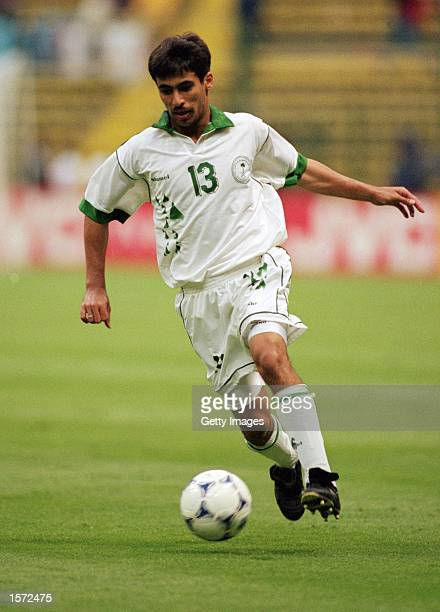 Hussein Sulimani of Saudi Arabia runs with the ball during the 1999 Confederations Cup match against Bolivia played at the Azteca Stadium in Mexico...