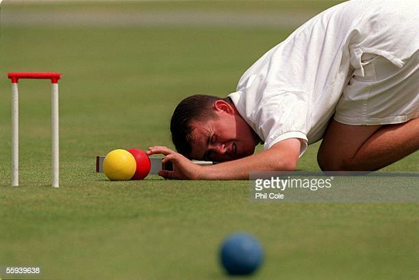 Jacques Fournier of the USA in action during the British Croquet Championships at the Hurlingham Club in Putney