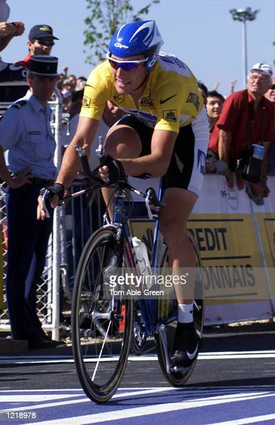 Lance Armstrong of the USA and the US Postal crosses the finish line to win the TimeTrial in Stage 19 held at Futuroscope in the 1999 Tour De France...