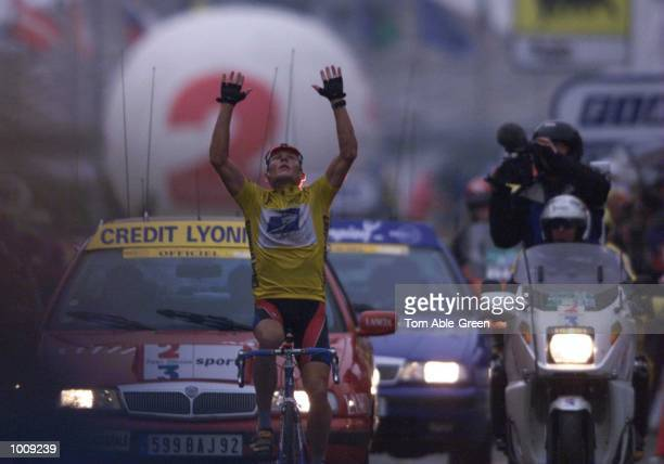 Lance Armstrong of the USA and the US Postal team celebrates victory in Stage 8 between Le Grand Bornand and Sestriere during the 1999 Tour De France...