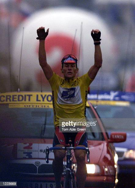 Lance Armstrong of the USA and the US Postal team celebrates retaining the Yellow Jersey in Stage 8 between Le Grand Bornand and Sestriere during the...