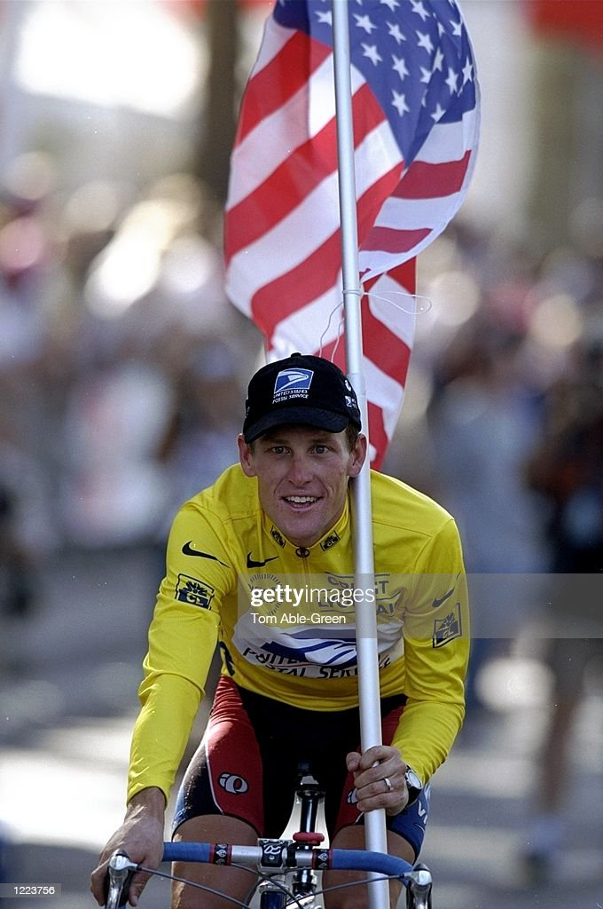 Lance Armstrong of USA and the US Postal team cycles round the Champs Elysees with the USA flag after winning the 1999 Tour de France on stage 20 between Arpajon and Paris, France. \ Mandatory Credit: Tom Able-Green /Allsport