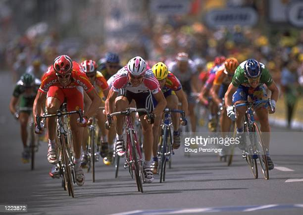 Mario Cipollini of Italy who rides for the Saeco-Cannondale team defeats Erik Zabel of Germany and Tom Steels of Belgium to win stage four of the...