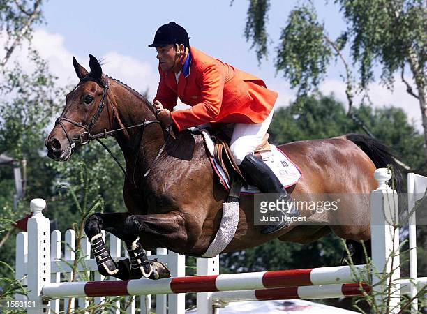 Mark Leone of The USA and Loro Piana Casino clear a fence in The Samsung Nations Cup held during The Traxdata Royal International Horse Show at the...