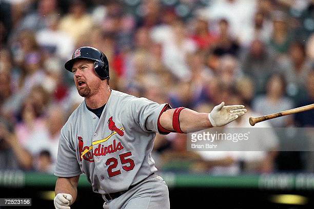 Mark McGwire of the St Louis Cardinals throws his bat during the game against the Colorado Rockies at the Coors Field in Denver Colorado The...