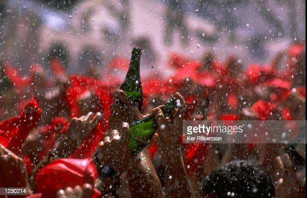 Midday Champagne celebrations at the San Fermin Fiesta 1999 in Pamplona Spain Noon on the 6th July sees the start of the San Fermin Fiesta in the...