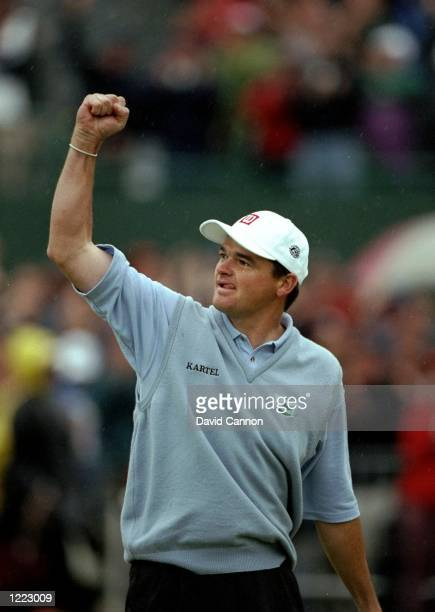 Paul Lawrie of Scotland celebrates winning the British Open title played at the Carnoustie GC in Carnoustie Scotland Mandatory Credit David Cannon...