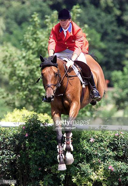 Peter Leone of The USA clears the first fence in the The Traxdata Sussex Stakes at The Traxdata Royal International Horse Show held at Hickstead...