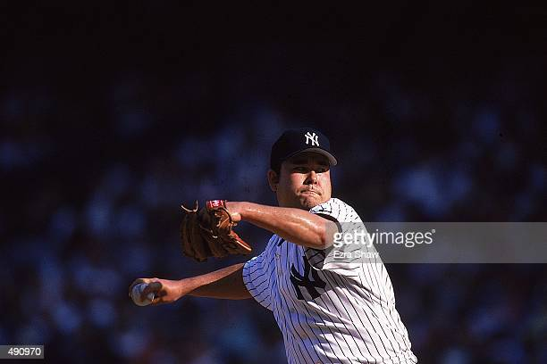 Pitcher Hideki Irabu of the New York Yankees winds back to throw the ball during a game against the Cleveland Indians at the Yankee Stadium in Bronx...