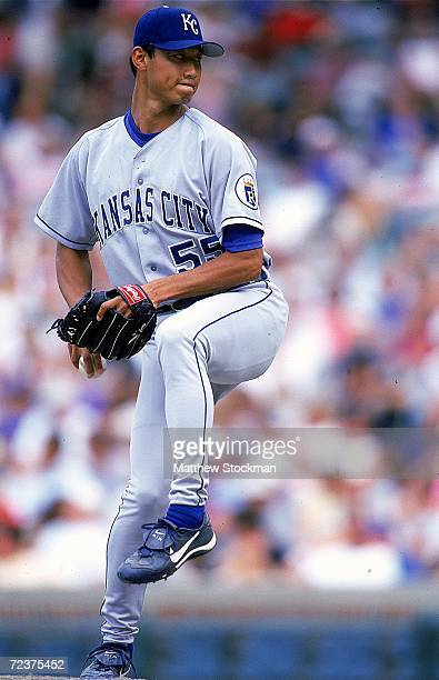 Pitcher Mac Suzuki of the Kansas City Royals winds back to pitch the ball during the game against the Chicago Cubs at Wrigley Field in Chicago...