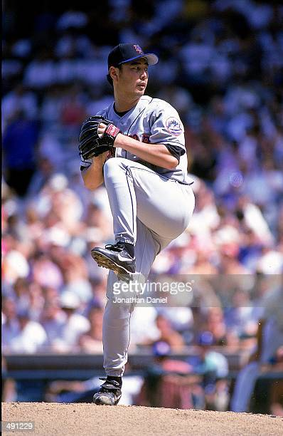 Pitcher Masato Yoshii of the New York Mets winds up for the pitch during the game against the Chicago Cubs at Wrigley Field in Chicago Illinois The...