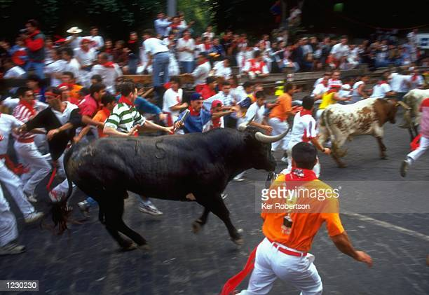Runners avoid the bulls in Telefonica during the San Fermin Fiesta 1999 in Pamplona, Spain. \ \ Noon on the 6th July sees the start of the San Fermin...
