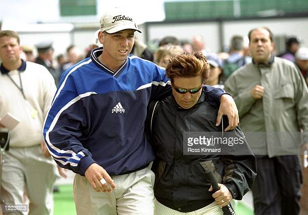 Sergio Garcia of Spain is comforted by his mother after shooting an 89 after the first round at the British Open played at the Carnoustie GC in...