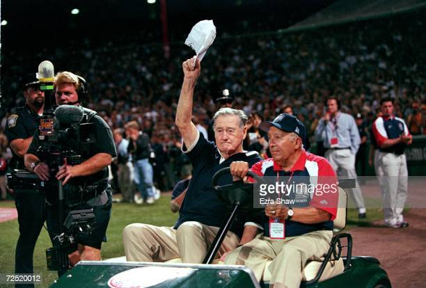 Ted Williams waves to the crowd as he is driven onto the field before the 1999 MLB AllStar Game against the National League Team and the American...