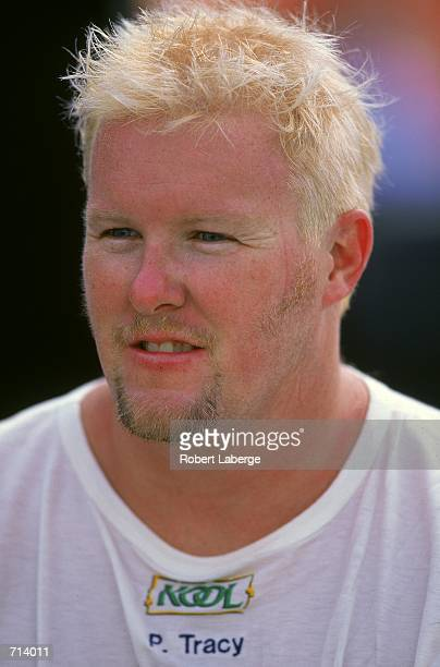 A close up of Driver Paul Tracy of Canada who drives the Honda Reynard 2KI for Team KOOL Green is looking on during the Target Grand Prix part of the...