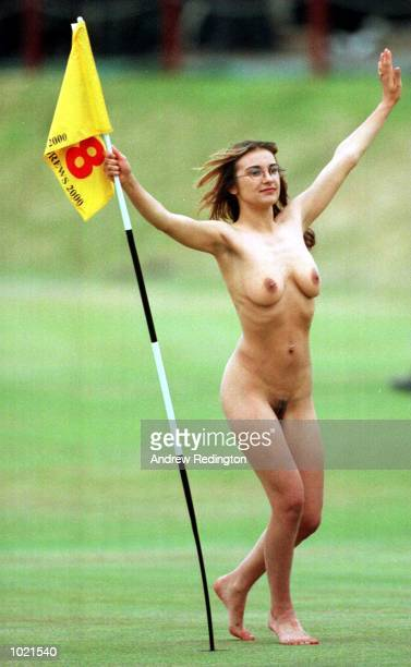 A female streaker on the 18th green as Tiger Woods of the USA makes his final putt during the final round of the British Open Golf Championships at...