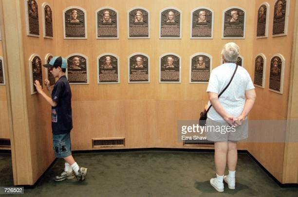 A general view of some fans looking at the Legends of Baseball plaques at the Baseball Hall of Fame in Cooperstown New YorkMandatory Credit Ezra O...
