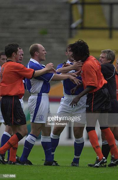A trialist for Dundee United clashes with Thomas Gravesen of Everton during the Dundee United v Everton Maurice Malpas Testimonial match at Tannadice...