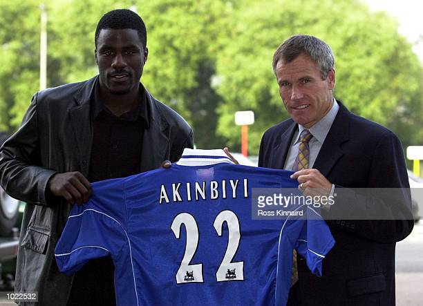 Ade Akinbiyi stands with manager Peter Taylor in front of the cameras after signing for Leicester City held in Leicester Mandatory Credit Ross...