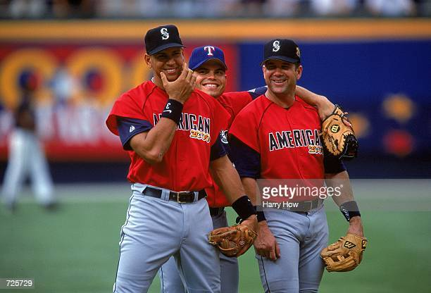 Alex Rodriguez Ivan Rodriguez and Edgar Martinez who play for the American League walk and smile for the camera during the AllStar Game against the...